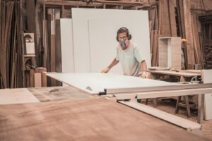 man-working-on-a-wooden-board-3637800